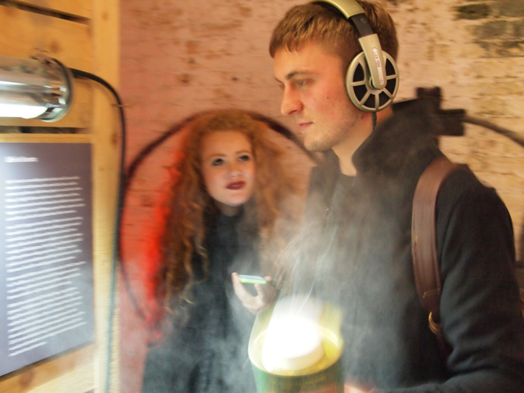 A couple looking at an exhibit amid a cloud of talcum powder