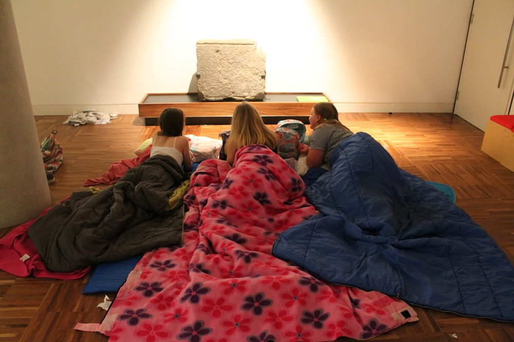 girls in sleeping bags in a museum
