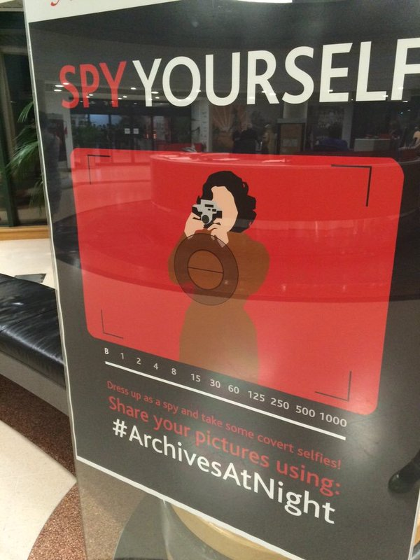 A poster inviting visitors to take and share hashtagged photos of themselves at an event