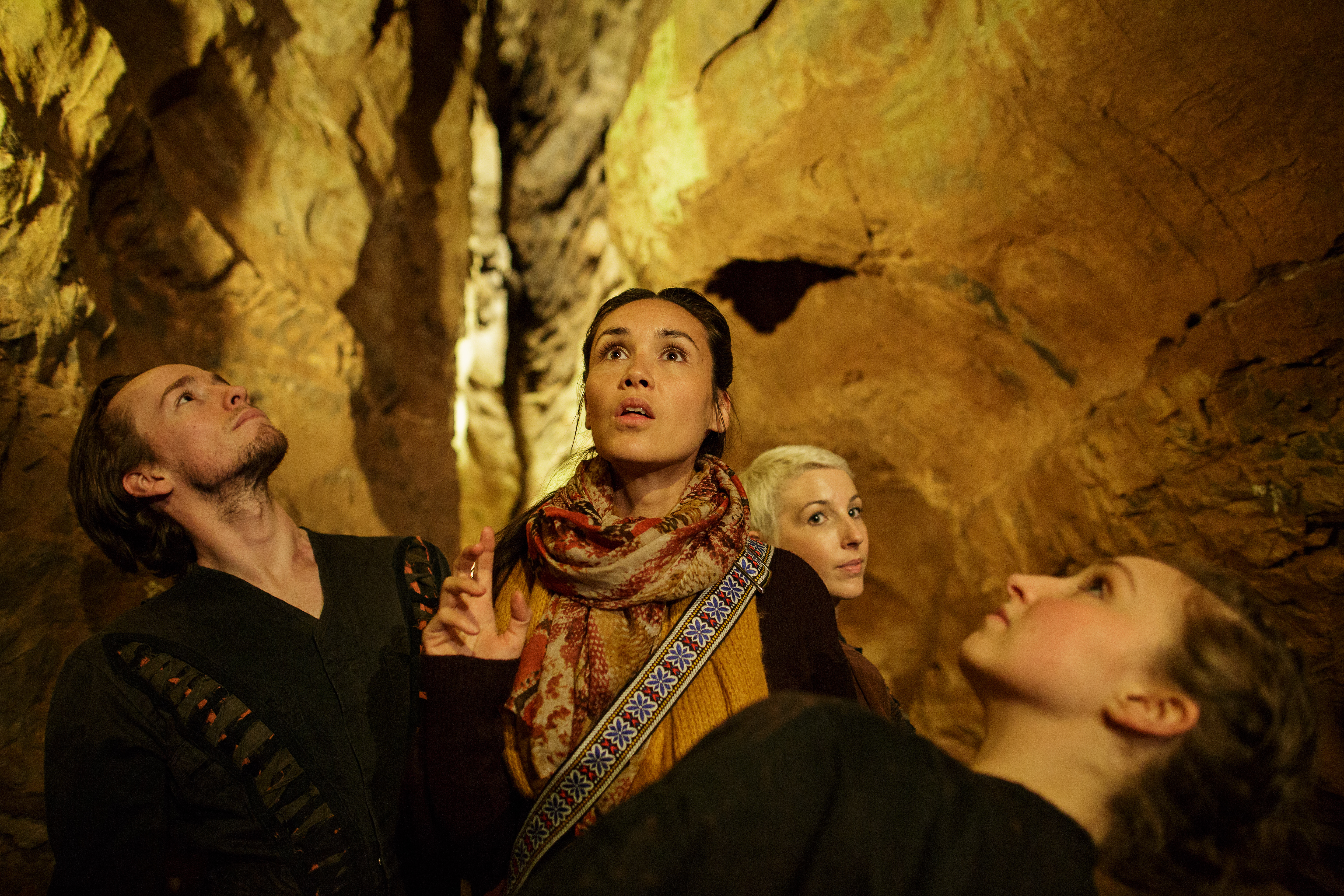 Dancers in cavern as part of Beneath Our Feet, Made By Katie Green