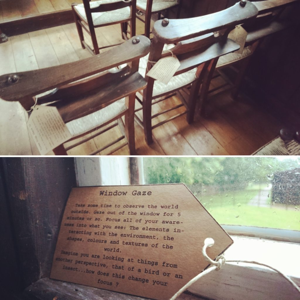 A photo of wooden chairs with paper tags tied to them, and a close up of a meditation tag in a window with instructions for 'window gazing'